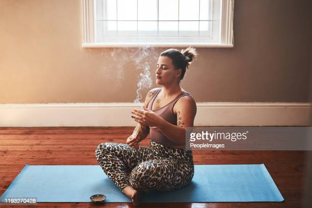 the smoke of palo santo sticks is so powerfully cleansing - incense stock pictures, royalty-free photos & images