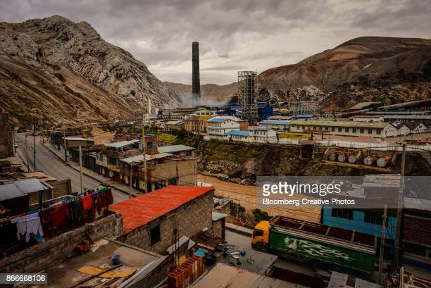 The smokestack of a refinery stands next to the Mantaro River in La Oroya, Peru