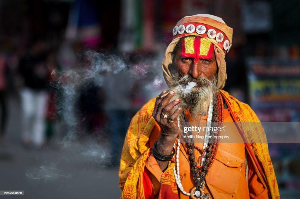 The smoking baba : Stock Photo