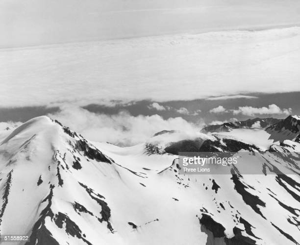 The smoking crater of Great Sitkin volcano on Great Sitkin Island in the Aleutian Islands of Alaska circa 1955