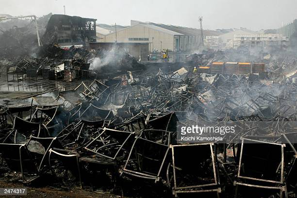 The smoldering ruins of a fire that consumed thousands of tires at the Bridgestone Corp plant is shown September 9 2003 in Kuroiso Utsunomiya in...