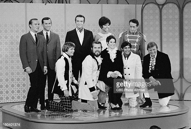 The Smothers Brothers Comedy Hour Standing from left Tom Smothers Dick Smothers Ricardo Montalban Diahann Carroll Pat Paulsen Kneeling from left...