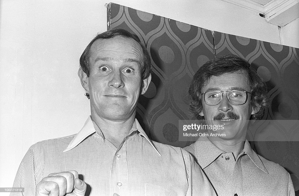 The Smothers Brothers L-R Tommy Smothers and Dick Smothers celebrate backstage after their 15th anniversary concert at the Troubadour on March 12, 1974, in West Hollywood, California. John Lennon and Harry Nilsson were kicked out of the show for drunken heckling.