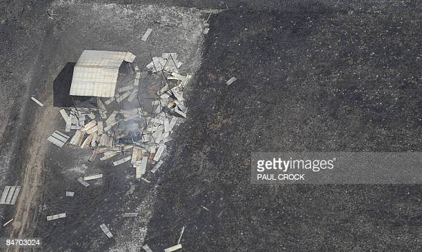 The smouldering remains of a hay shed shows the devastation of the wildfires which swept across the Latrobe Valley near Bunyip West Gippsland some...