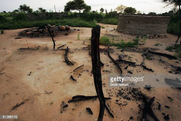 The smouldering remains of the village of Chero Kasi are seen here September 8 a day after it was set ablaze by Janjaweed militiamen in the violence...