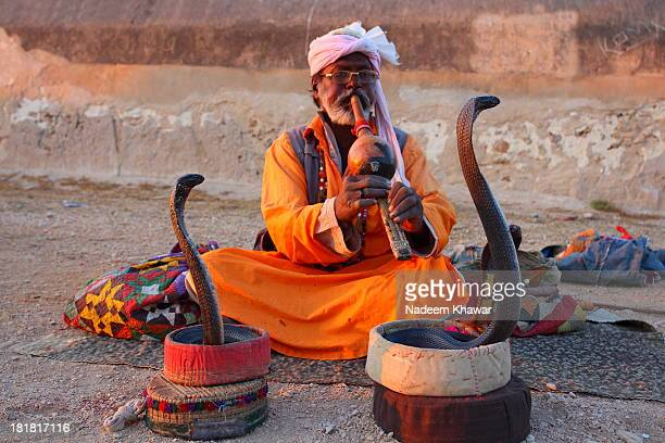 The snack Charmer at Makli graveyard,Makli, Thatta, Sindh-Pakistan. Snake charming is the practice of pretending to hypnotise a snake by playing an...