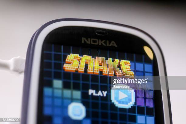The snake games sits on the screen of a Nokia 3310 mobile phone manufactured by HMD Global Oy on the opening day of the Mobile World Congress in...