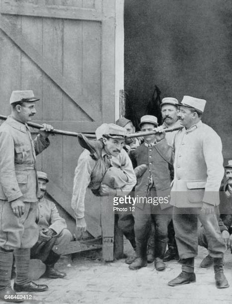 A contortionist entertaining his fellow French soldiers by performing seemingly impossible contortions From Le Flambeau Paris September 1915 First...