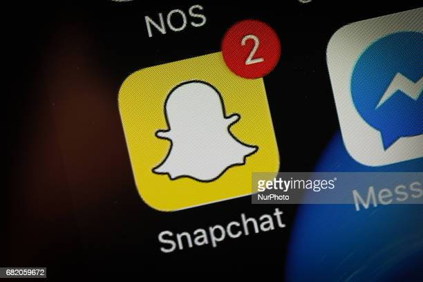 THe Snapchat app is seen on an iPhone on 10 May 2017 Snap inc Snapchats parent company recently announced it will allow users to make Snaps of...