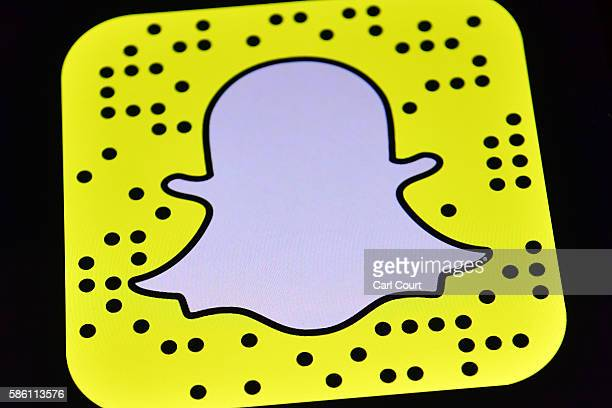 The Snapchat app logo is displayed on an iPad on August 3 2016 in London England