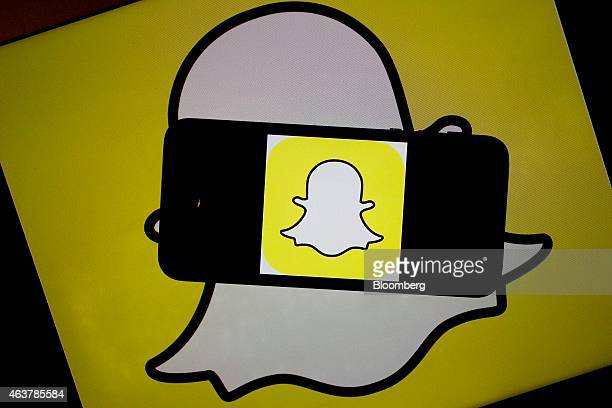 The Snapchat Inc logo is displayed for a photograph on an Apple Inc iPhone 5s and laptop computer in Washington DC US on Wednesday Feb 18 2015...