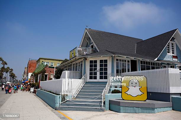 The Snapchat Inc logo stands outside the company's headquarters on the strand at Venice Beach in Los Angeles California US on Wednesday Aug 14 2013...