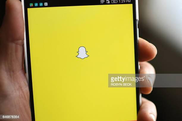 The Snapchat logo is displayed on a mobile phone March 1 2017 in Glendale California After a dearth of technology listings in 2016 Snapchat parent...