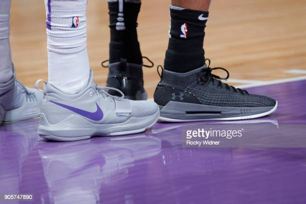 The sneakers belonging to Garrett Temple of the Sacramento Kings and Patty Mills of the San Antonio Spurs during the game on January 8 2018 at Golden...