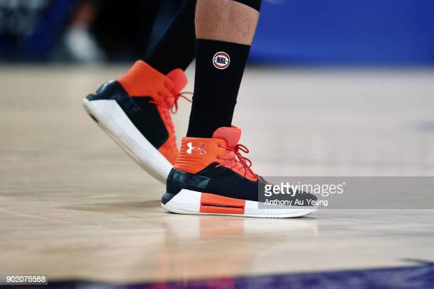 The sneakers of Alex Loughton of the Taipans are seen during the round 13 NBL match between the New Zealand Breakers and the Cairns Taipans at Spark...