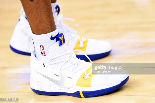 The sneakers of Andre Iguodala of the Golden State Warriors are seen against the Phoenix Suns on March 10 2019 at ORACLE Arena in Oakland California...