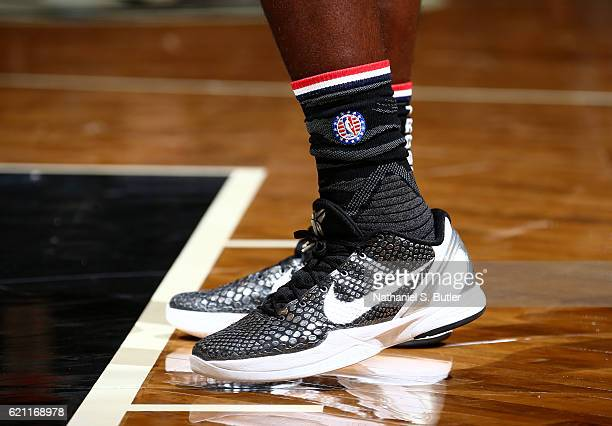 The sneakers of Anthony Bennett of the Brooklyn Nets who is wearing hoops for troops socks honoring members of the US armed forces and their families...
