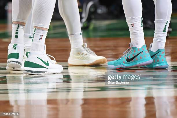The sneakers of Aron Baynes and Kyrie Irving of the Boston Celtics during the game against the Denver Nuggets on December 13 2017 at the TD Garden in...