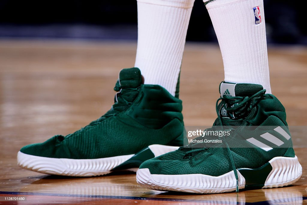 eb987114aa4 The sneakers of Brook Lopez of the Milwaukee Bucks are seen against ...