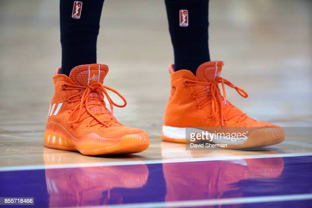 The sneakers of Candace Parker of the Los Angeles Sparks are seen during the game against the Minnesota Lynx in Game Three of the 2017 WNBA Finals on...