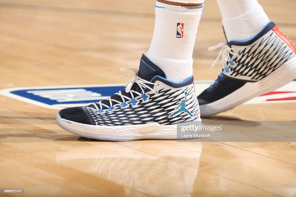 The sneakers of Carmelo Anthony #7 of the Oklahoma City Thunder are seen during the game against the Utah Jazz on December 5, 2017 at Chesapeake Energy Arena in Oklahoma City, Oklahoma.