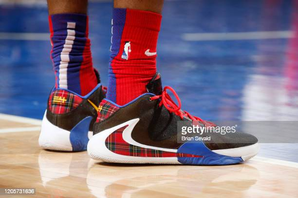 The sneakers of Christian Wood of the Detroit Pistons during the game against the Utah Jazz on March 7 2020 at Little Caesars Arena in Detroit...