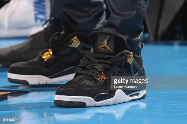 The sneakers of Daniel Hamilton of the Oklahoma City Thunder during the game against the Sacramento Kings on March 12 2018 at Chesapeake Energy Arena...