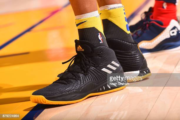 The sneakers of David West of the Golden State Warriors are seen during the game against the New Orleans Pelicans on November 25 2017 at ORACLE Arena...