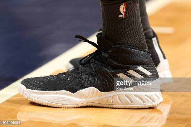 The sneakers of DeMarre Carroll of the Brooklyn Nets are seen during the game against the Charlotte Hornets on March 8 2018 at Spectrum Center in...