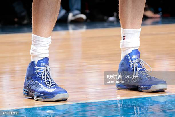 The sneakers of Dirk Nowitzki of the Dallas Mavericks against the Houston Rockets during Game Three of the Western Conference Quarterfinals of the...