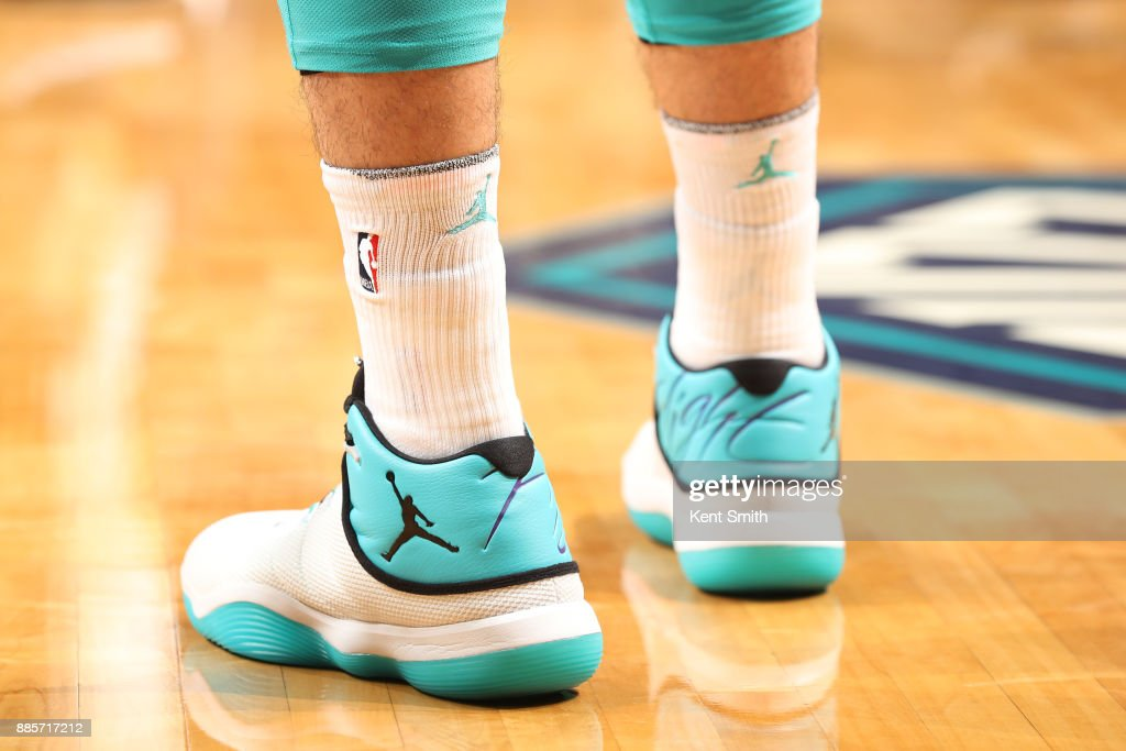 The sneakers of Frank Kaminsky #44 of the Charlotte Hornets as they play against the Orlando Magic on December 4, 2017 at Spectrum Center in Charlotte, North Carolina.