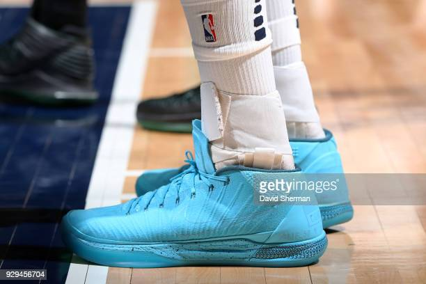 The sneakers of Gorgui Dieng of the Minnesota Timberwolves during the game against the Boston Celtics on March 8 2018 at Target Center in Minneapolis...
