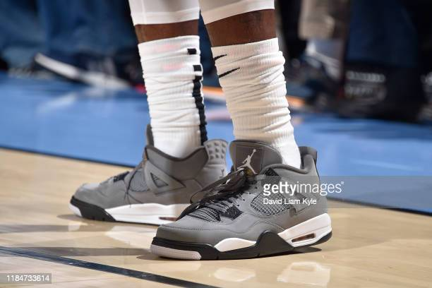 The sneakers of Iman Shumpert of the Brooklyn Nets are worn during a game against the Cleveland Cavaliers on November 25 2019 at Quicken Loans Arena...