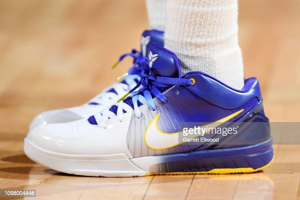 9137768eebbf The sneakers of Isaiah Thomas of the Denver Nuggets are seen against the  Miami Heat on