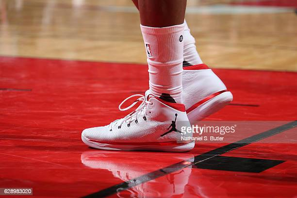 The sneakers of Jimmy Butler of the Chicago Bulls are seen during a game against the Miami Heat on December 10 2016 at the United Center in Chicago...