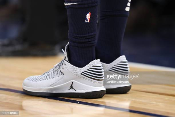 The sneakers of Jimmy Butler of the Minnesota Timberwolves are seen during the game against the Sacramento Kings on February 11 2018 at Target Center...