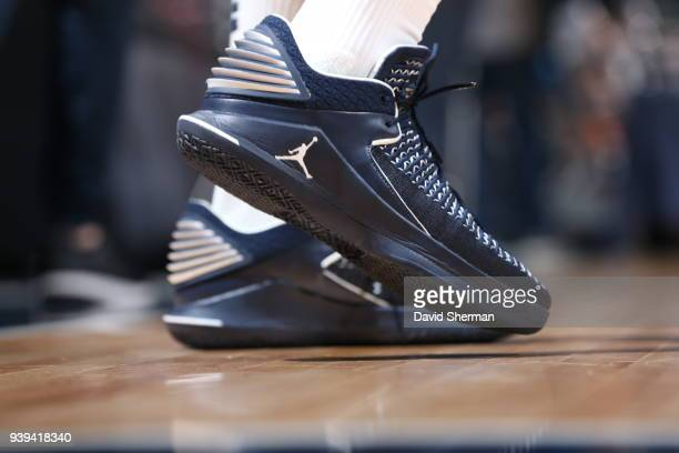 The sneakers of Jimmy Butler of the Minnesota Timberwolves are seen before the game against the Atlanta Hawks on March 28 2018 at Target Center in...