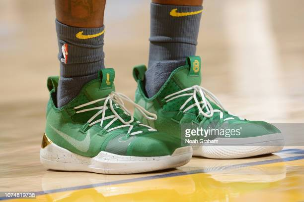 The sneakers of Jordan Bell of the Golden State Warriors are seen against the Los Angeles Lakers on December 25 2018 at ORACLE Arena in Oakland...
