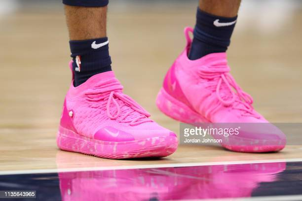 The sneakers of Keita BatesDiop of the Minnesota Timberwolves as seen during the game against the Oklahoma City Thunder on April 7 2019 at Target...