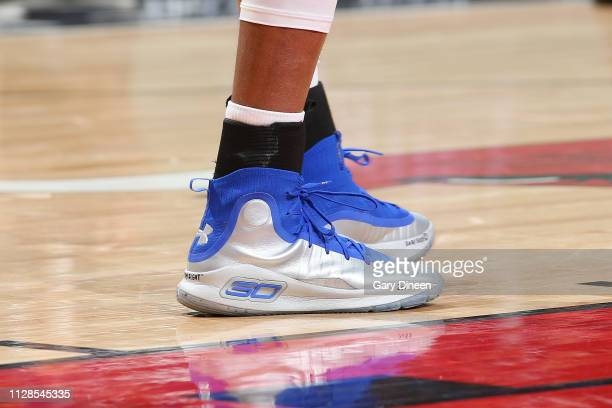 The sneakers of Kent Bazemore of the Atlanta Hawks as seen during the game against the Chicago Bulls on March 3 2019 at the United Center in Chicago...