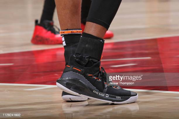 The sneakers of Kent Bazemore of the Atlanta Hawks during the game against the San Antonio Spurs on March 6 2019 at State Farm Arena in Atlanta...