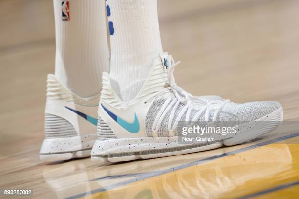The sneakers of Kevin Durant of the Golden State Warriors are seen during the game against the Dallas Mavericks on December 14 2017 at ORACLE Arena...
