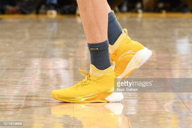 The sneakers of Klay Thompson of the Golden State Warriors are seen against the Los Angeles Lakers on December 25 2018 at ORACLE Arena in Oakland...
