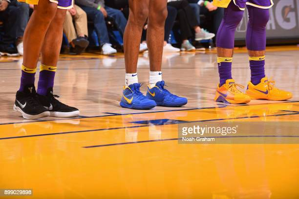 The sneakers of Kyle Kuzma Kentavious CaldwellPope of the Los Angeles Lakers and Patrick McCaw of the Golden State Warriors during on December 22...