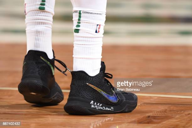 The sneakers of Kyrie Irving of the Boston Celtics are seen before the game against the Milwaukee Bucks on December 4 2017 at the TD Garden in Boston...