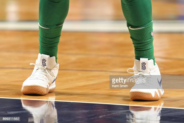 The sneakers of Kyrie Irving of the Boston Celtics during the game against the Charlotte Hornets on December 27 2017 at Spectrum Center in Charlotte...