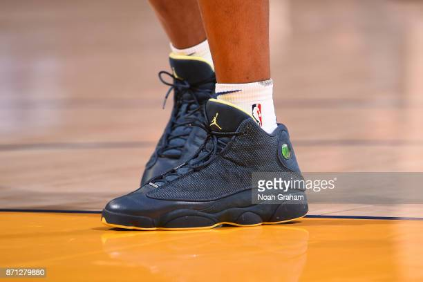 The sneakers of Patrick McCaw of the Golden State Warriors before the game against the Miami Heat on November 6 2017 at ORACLE Arena in Oakland...