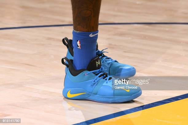 The sneakers of Paul George of the Oklahoma City Thunder are seen during the game against the Golden State Warriors on February 6 2018 at ORACLE...