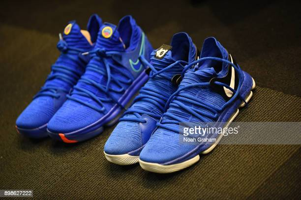 The sneakers of Quinn Cook of the Golden State Warriors and Chris Boucher of the Golden State Warriors are displayed in the locker room before the...