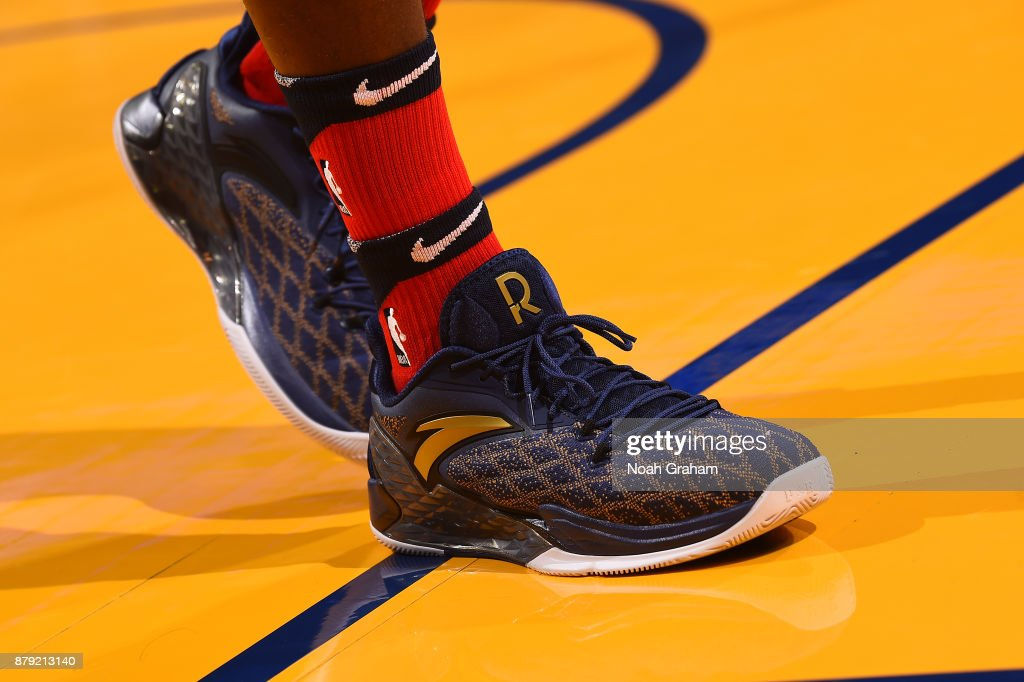 The sneakers of Rajon Rondo #9 of the New Orleans Pelicans are seen during the game against the Golden State Warriors on November 25, 2017 at ORACLE Arena in Oakland, California.